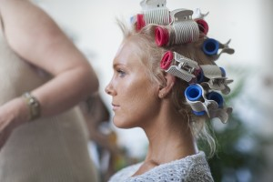 Profile of model with hair rollers