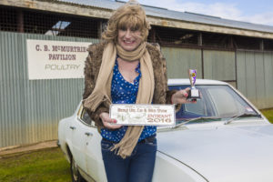 Here's Denise at the car, displaying her trophies...oh, there you go...she also got a trophey...not bad!